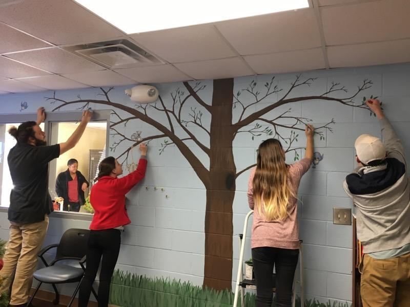 Gillis and Students painting a tree